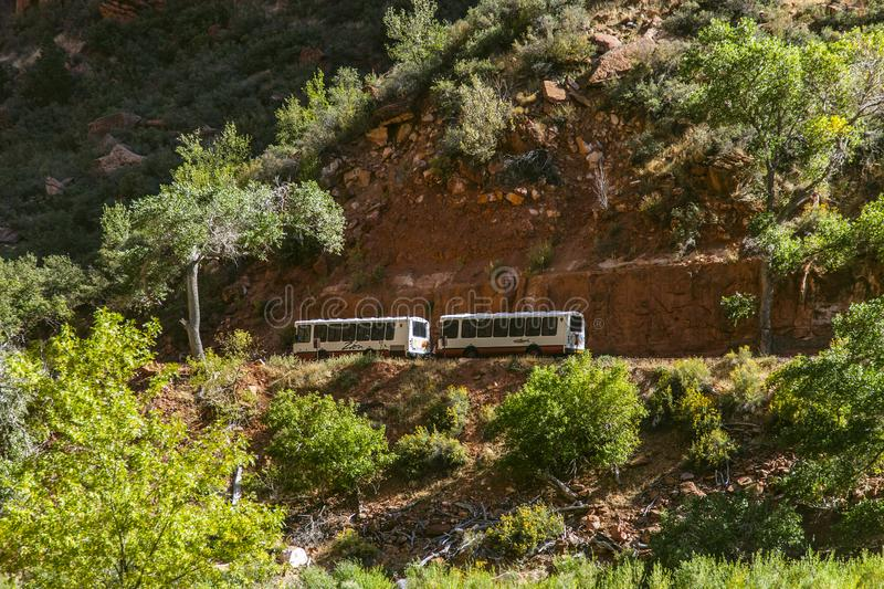 Responsible bus transport through Zion National Park in America. The use of energy-efficient buses tries to keep transport in Zion National park manageable and stock photography