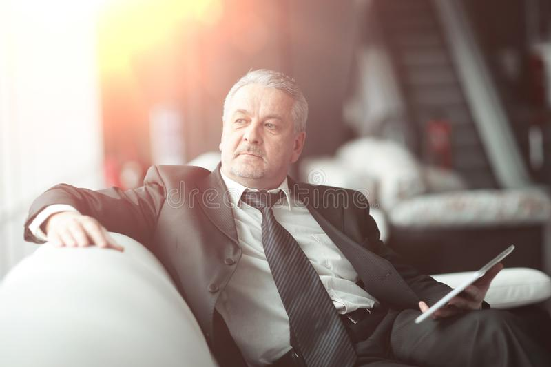 Responsible businessman sitting in modern office.people and technology.  stock photos