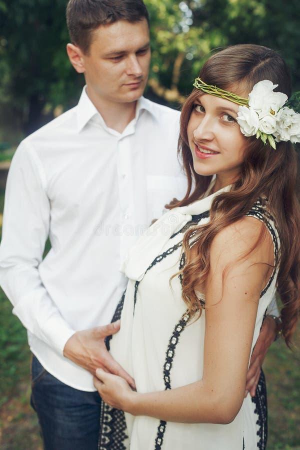 Responsible husband hugging beautiful stylish wife in retro whit royalty free stock image