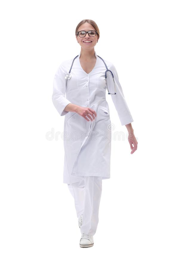 Responsible medical doctor is a woman stepping forward . isolated on white. Background royalty free stock photos