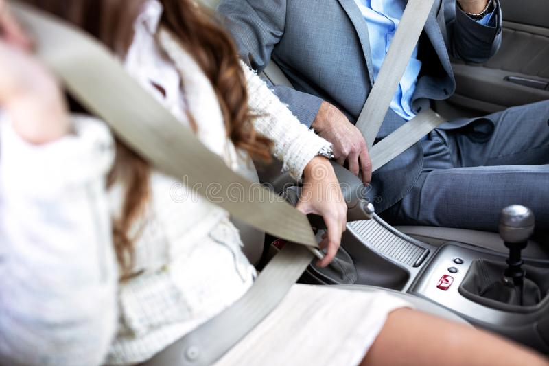 Responsible people placing safety as their priority. By putting the seatbelt on before driving royalty free stock photo