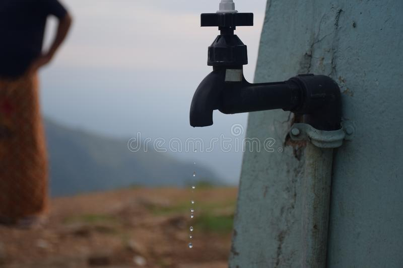 Wastage of water from a tap royalty free stock image