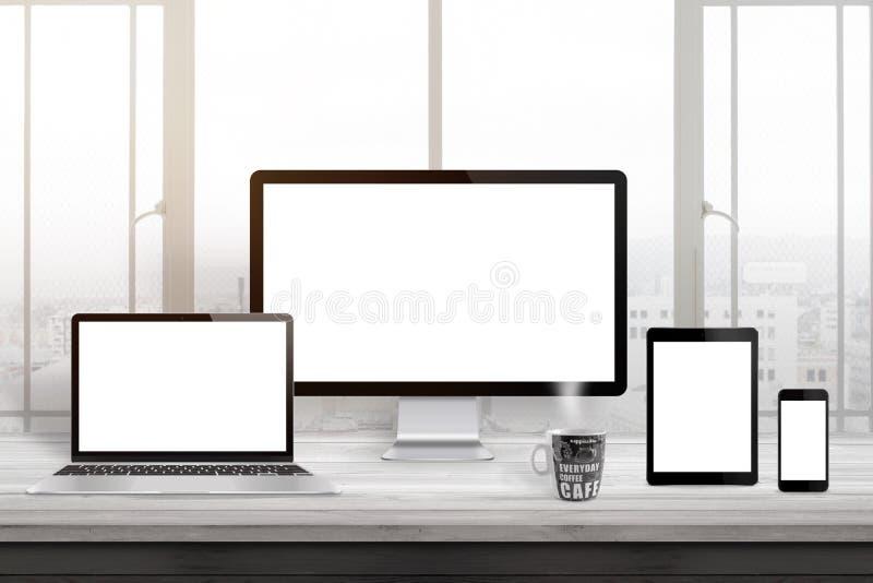 Responsive web site design mockup. Computer displaz, laptop, tablet and smart phone on office desk stock images