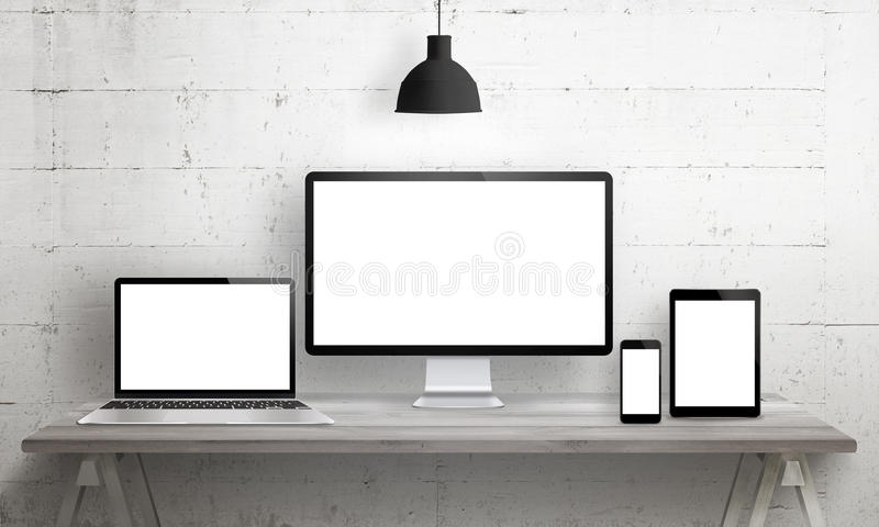Responsive web site mockup. Computer display, laptop, tablet and smart phone on desk with isolated, blank, white screen for design presentation stock illustration