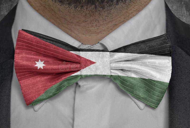 Ressortissant de drapeau de la Jordanie sur le costume d'homme d'affaires de bowtie illustration stock