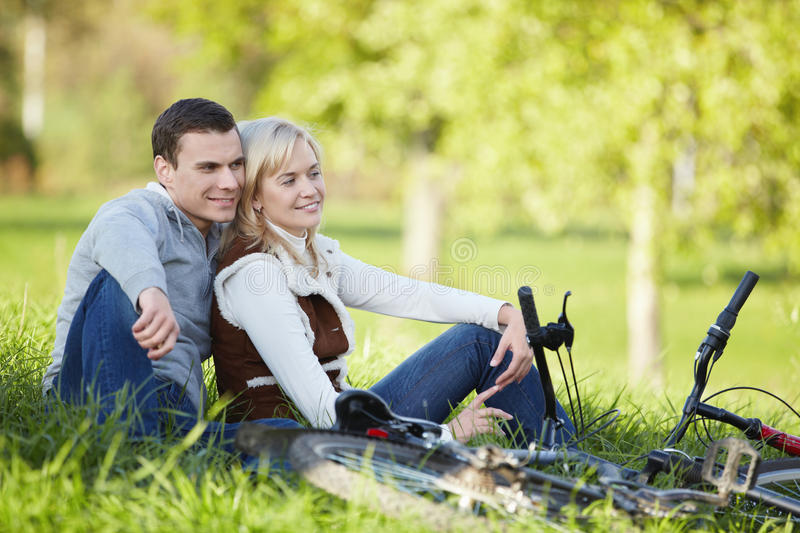 Rest. A couple with bikes in autumn park royalty free stock photography