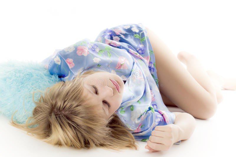 Rest. The blonde lies on a white background blindly royalty free stock images