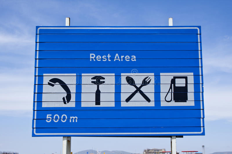 Rest area sign. Near the Rest area sign on the highway road stock photography