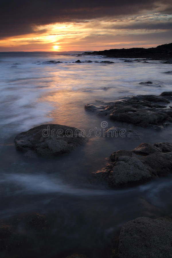 Rest Bay, Porthcawl, South Wales. Sunset at Rest Bay, Porthcawl, South Wales, during the warm weather enjoyed by the UK stock images