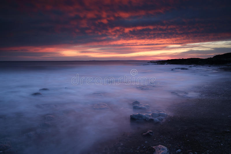Rest Bay, Porthcawl, South Wales. Sunset at Rest Bay, Porthcawl, South Wales, during the warm weather enjoyed by the UK royalty free stock image