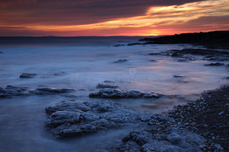 Rest Bay, Porthcawl, South Wales. Sunset at Rest Bay, Porthcawl, South Wales, during the warm weather enjoyed by the UK royalty free stock photos