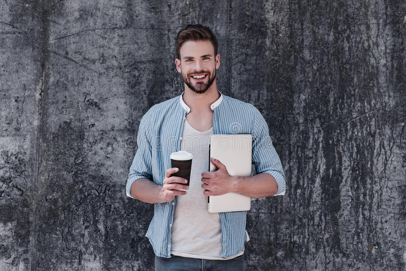Rest and be thankful. Handsome brown-haired man with blue eyes standing isolated over grey background stock photos