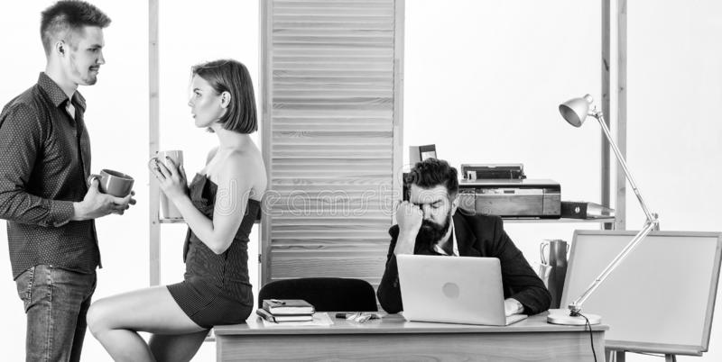 Rest break at work. Business partners enjoying conversation in lunch break while colleague working in background. Young royalty free stock photo