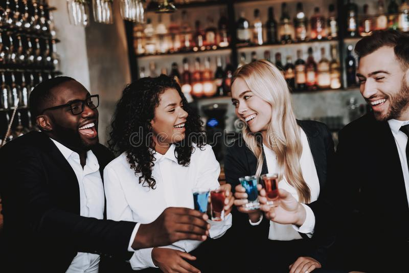 Rest. Drink Alcoholic Beverages. Girls and Guys. Drink Alcoholic Beverages. Girls and Guys Bar Together. Different Races Communicate. Young People Rest Have Fun royalty free stock images