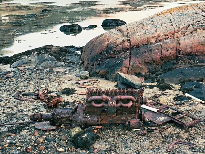 Rest of engine block of sunken boat. Abandoned motor of Shipwreck at sea. Rest of engine block of sunken boat. Abandoned motor of Shipwreck at the sea stock photography
