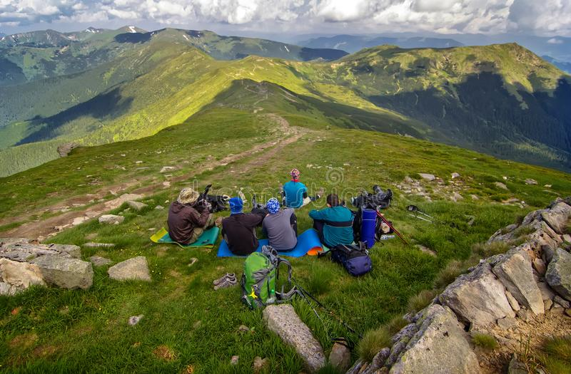 Rest group of tourists on top of the mountain stock photos
