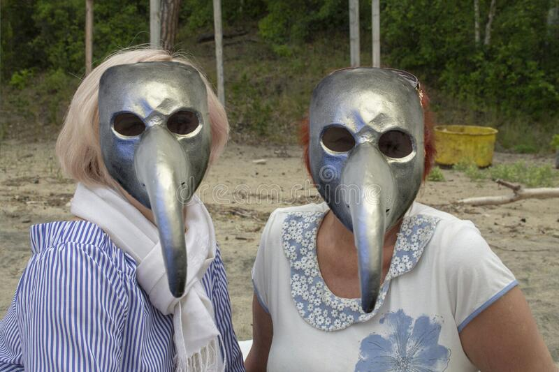 Rest on the lake in anti plague masks stock photography
