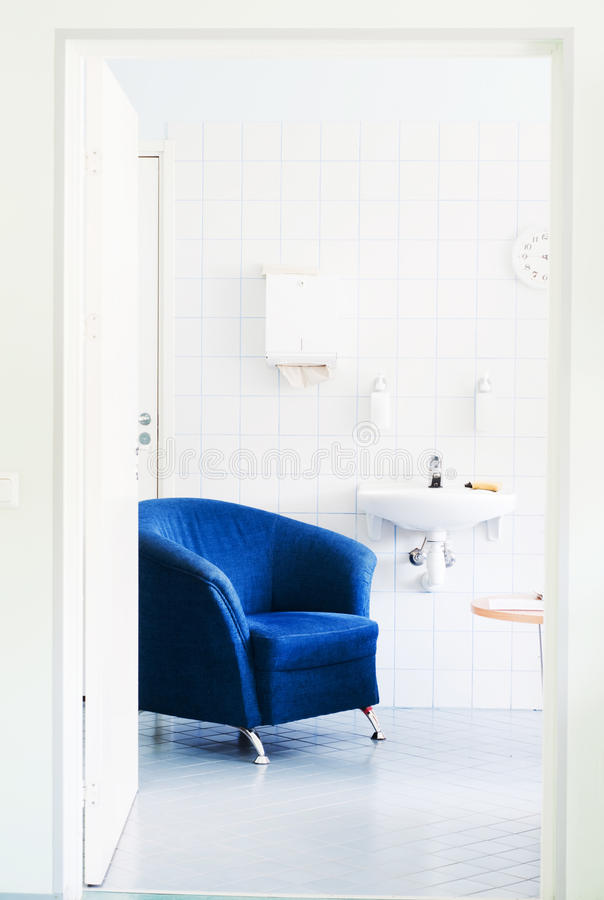 Rest room in hospital. Shot of rest room in hospital, blue armchair stock photos