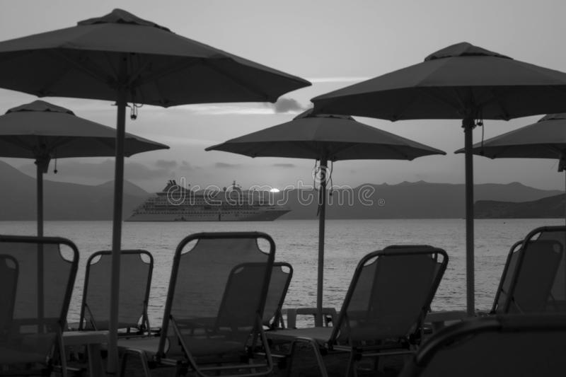 Rest on the shore and on a cruise ship black and white photo royalty free stock photography