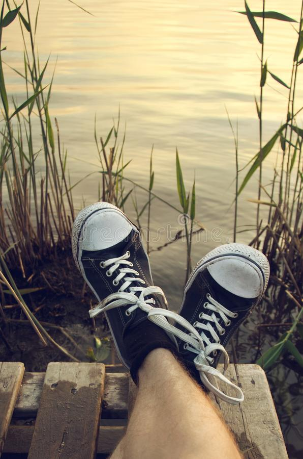 Rest on the shore of the pond. royalty free stock photo