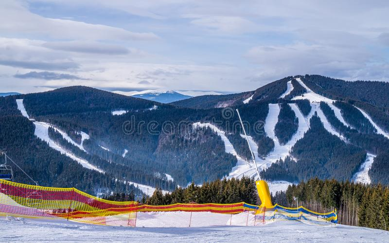 Winter holidays at a ski resort. Snow skiing in the forest stock image