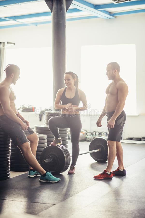 Rest three friends who have completed a complex crossfit workout stock images