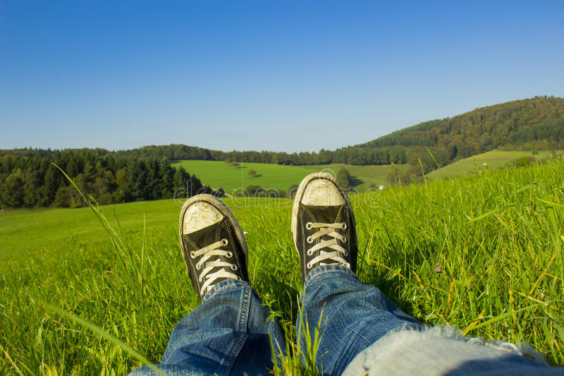 Rest in the weed. Shoe selfie resting in the weed stock image