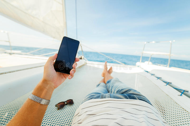 Rest on a yacht. In the first person. Feet first person stock images