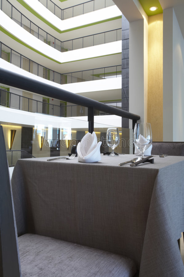 In restaurant. Fragment like view of table setting at modern restaurant stock images