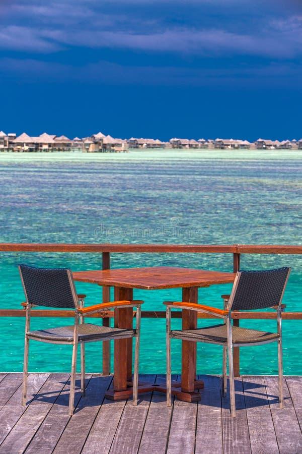 Restaurant above the beautiful lagoon on tropical Island, Maldives stock photo
