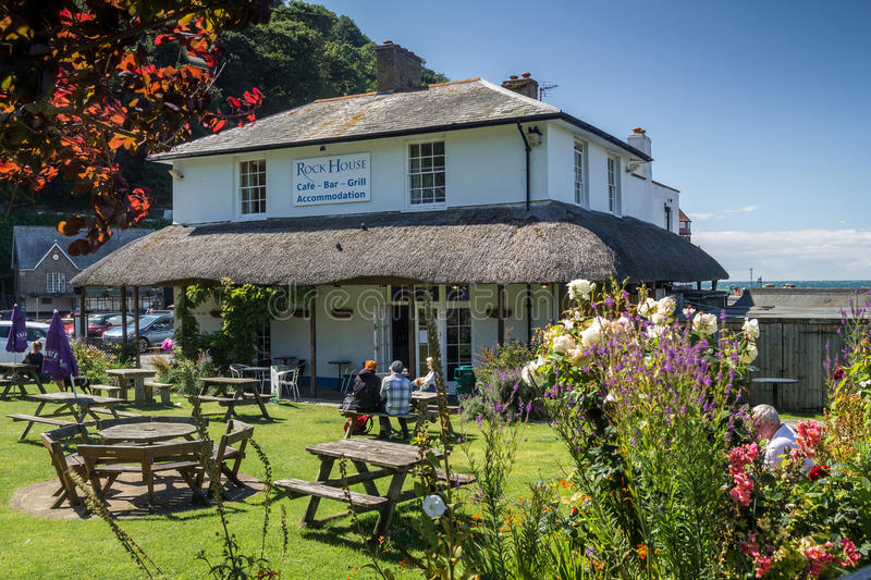 Restaurant and Accommodations - Rock House. Lynmouth, North Devon, England, 13 July 2016: Restaurant and Accommodations - Rock House. People sit at tables in the stock image