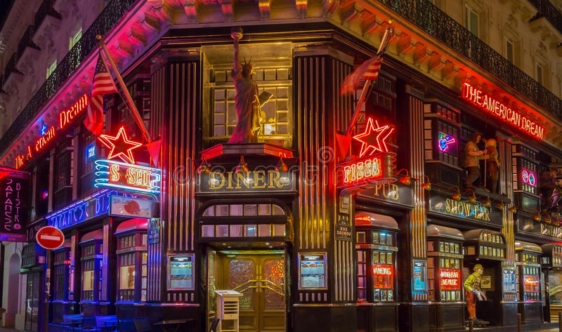 The restaurant American Dream at night, Paris, France. Paris, France-October 06, 2016: The American Dream is a famous restaurant and entertainment venue in royalty free stock photo