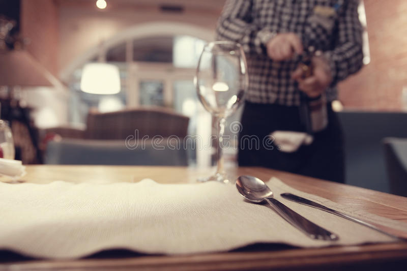 Restaurant background. Waiter in the restaurant caters royalty free stock photo