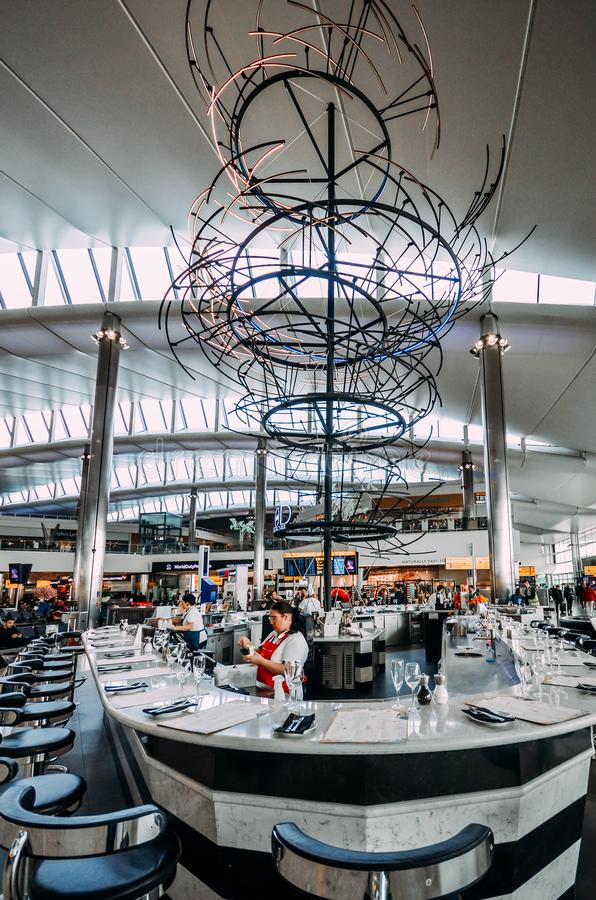 Restaurant and bar with modern structure at departure terminal, Heathrow Terminal 3. London, England, Feb 13, 2019: Restaurant and bar with modern structure at royalty free stock photography