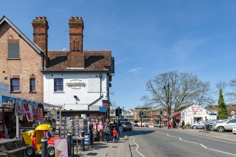 Restaurant, bar, and souvenir shop on River Street in downtown Windsor, Berkshire, England. Windsor, UK - April 2018: Restaurant, bar, and souvenir shop on River stock image