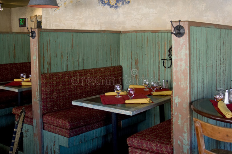 Restaurant Booth. A rustic booth with a table setting at mexican restaurant or charming cafe royalty free stock photos