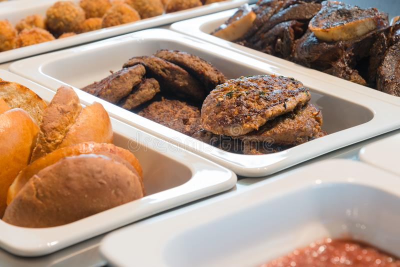 Restaurant buffet, burger meal, catering business. Self service buffet at a restaurant. Burger meal royalty free stock photo