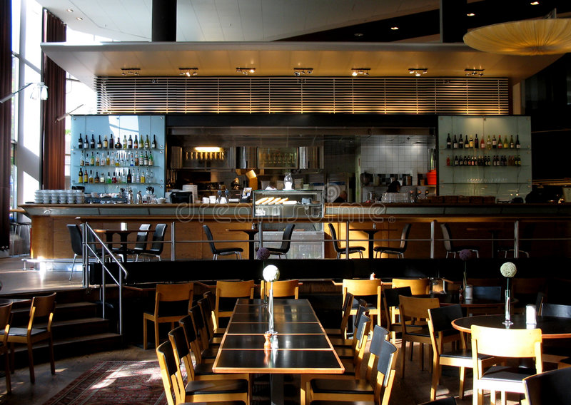 Restaurant or cafe. With open kitchen and bar stock photography