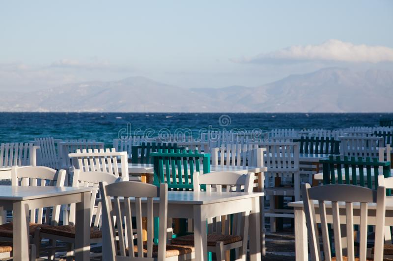 restaurant chairs and tables by the sea royalty free stock images