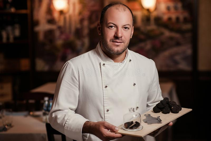 Restaurant chef delicacy. truffle food mushroom. Restaurant chef delicacy. truffle vegan food mushroom waiter service meal royalty free stock photos
