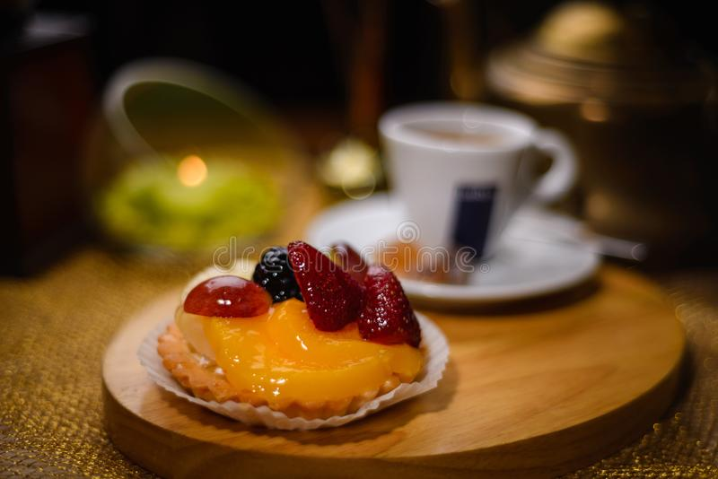 Sweet dessert with fruits and berries, in the background coffee royalty free stock images