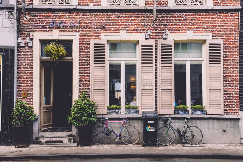 Restaurant Door, Wall and Bikes in Ghent royalty free stock photography
