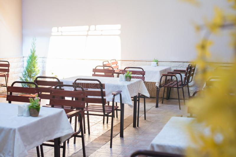 Restaurant empty table and chairs, Cafe terrace table. And chairs royalty free stock photos