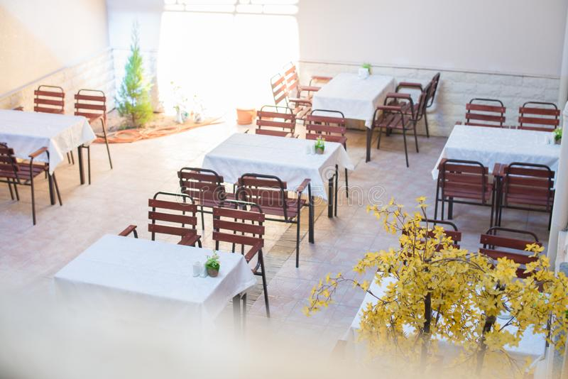 Restaurant empty table and chairs, Cafe terrace table. And chairs stock images