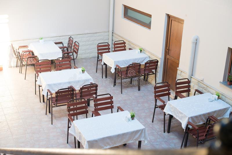 Restaurant empty table and chairs, Cafe terrace table. And chairs royalty free stock photo