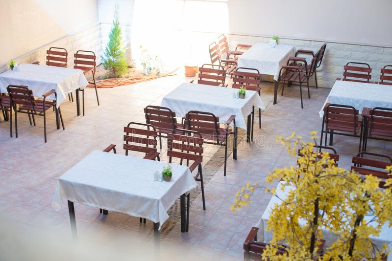 Restaurant empty table and chairs, Cafe terrace table. And chairs stock photos