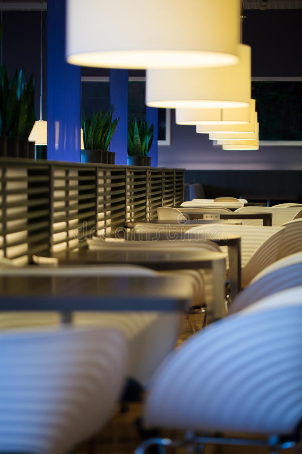 Restaurant with empty tables and chairs. Bar or restaurant with empty tables and chairs in modern design royalty free stock photography