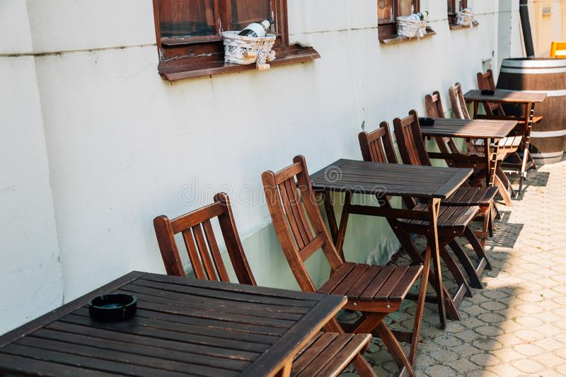 Restaurant empty tables and chairs in Lednice, Czech Republic. Europe royalty free stock photo