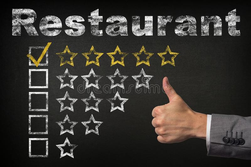 Restaurant five 5 star rating. thumbs up service golden rating stars on chalkboard stock photo