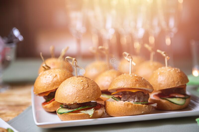 Restaurant food mini burger table with snack delicious dining. Catering service.  royalty free stock photo